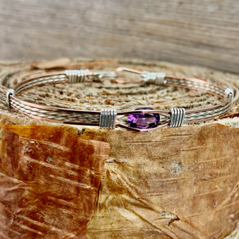 "IN STOCK is a Rose Gold and Argentium Sterling Silver bracelet paired up with silver wrap wires. This royal looking Amethyst makes a wonderful addition to anyones jewelry accessories. When Faux just won't do! This bracelet is a finished size 7"". Should you need a different size, please refer to the CUSTOM TAB instead to place your order."
