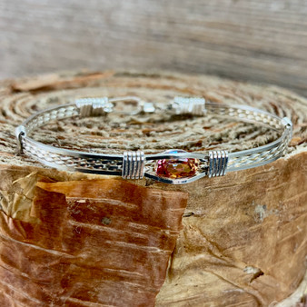 """Express yourself with this fun everyday choice """"Go To""""  accessory! This photo shows an all silver bracelet band with a Anastasia Gemstone. This is a great all round bracelet that will not only become an heirloom but honestly you can wear this with everything! Fit for a queen!"""