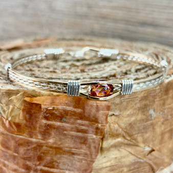 "This stunning gemstone is an Anastasia Topaz paired up with a Yellow Gold and Silver classic bracelet band. We stock a true size 7"" finished but occasionally offer this IN STOCK in additional sizes due to its popularity. Please message us if you are in a hurry for a special gift idea and we will be happy to check on additional items IN STOCK. The bracelet shown is IN STOCK currently in a 7"" band."