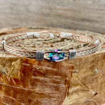 Shown is a CUSTOM Rose Gold and Silver faceted bracelet with a heat irradiated Rainbow Topaz with your finished bracelet size. This bracelet features an Argentium sterling silver wraps over the band making it predominantly a Silver look with Rose Gold accent. We also offer this bracelet in a gold  wrap accent. CUSTOM orders are available for all of our bracelet selections. Place your order through this CUSTOM tab.