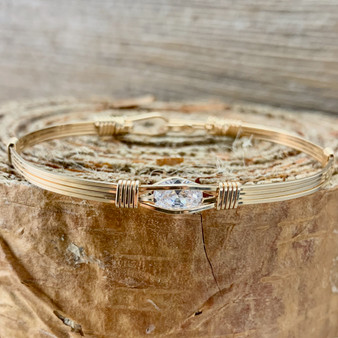 """Shown is an IN STOCK 7"""" finished all yellow gold Swarovski Cubic Zirconia Gemstone bracelet featuring a Minimalist band design. This clean streamline band makes this choice a no-fuss option! We only offer this style once in awhile."""
