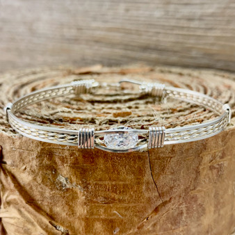 This Wire Wrap Bracelet is sure to be a hit! The Swavorski Cubic Zirconia Gemstone bracelet is sure to become your next favorite timeless treasure! Feel like a princess today, with this dazzling, fun bracelet. Our customers repeatedly state that they get so many compliments, you will too!