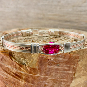 Be dazzled by the Synthetic Ruby handcrafted gemstone bracelet. This Ruby is a deep pink red color with exceptional clarity. Much more affordable than its natural counterpart, this beauty is sure to be a treasure for years to come.