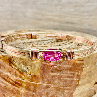 "Be dazzled by this Blush Topaz handcrafted gemstone bracelet. This Topaz is a deep bright pink color with exceptional clarity and is a heat irradiated gemstone. Another name for that is it is an ""enhanced"" gemstone. This is available in a yellow and rose gold classic bracelet band. This beauty is sure to be a treasure for years to come."