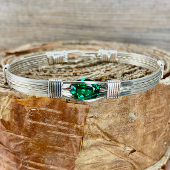 May's birthstone is a striking bright crisp green color. This Synthetic Emerald Wire Wrap Bracelet is shown in Argentium Sterling Silver but available with 20 different metal combinations and 5 different bracelet band styles. We also custom size for whatever finished bracelet you need to fit properly. HAVE IT YOUR WAY.