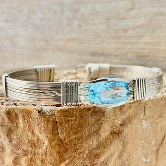 """Featured and IN STOCK is a Blue Topaz faceted gemstone bracelet shown in Argentium Sterling Silver. This gemstone is beautiful in any metal. We offer a quality item at an affordable price. See the difference a handcrafted jewelry items is from the """"Treasures From Heaven Collection"""". Satisfaction Guaranteed."""