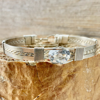 """Be the """"Talk of the town"""" with this classic style all silver faceted wire wrap bracelet. This White Topaz is by far our best selling natural gemstone. Looks like a diamond but without the price tag! Enjoy this beauty for many years to come, truly a treasure from heaven."""