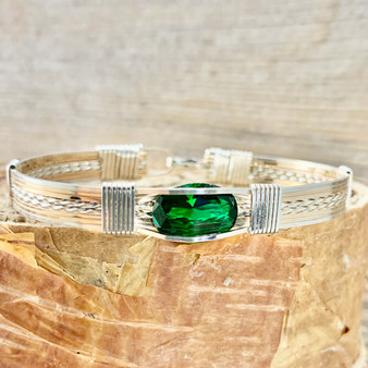 May's birthstone is a striking bright crisp green color. This IN STOCK  Synthetic Emerald Wire Wrap Bracelet is shown in Silver and Yellow Gold bracelet band but also available with 21 different metal combinations and 5 different bracelet band styles. We also custom size for whatever finished bracelet you need to fit properly. HAVE IT YOUR WAY.