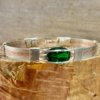 May's birthstone is a striking bright crisp green color. This IN STOCK  Synthetic Emerald Wire Wrap Bracelet is shown in Silver and Rose Gold bracelet band but also available with 21 different metal combinations and 5 different bracelet band styles. We also custom size for whatever finished bracelet you need to fit properly. HAVE IT YOUR WAY.