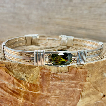"Shown is an all Argentium Silver and Yellow Gold 8 wire bracelet with a New Classic style band with a Synthetic Peridot. This silver metal is so sweet, taking on a platinum patina when it oxidizes but never getting black. This is very compatible with white gold. Enjoy this ""Treasure From Heaven"" for years to come."