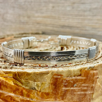 "Style 821S is a Classic style all Argentium Sterling Silver bracelet is such a staple when it comes to everyday wearability. Shown in an all silver 8 wire band, its sure to become your ""GO TO"" choice on your way out the door for work or play."