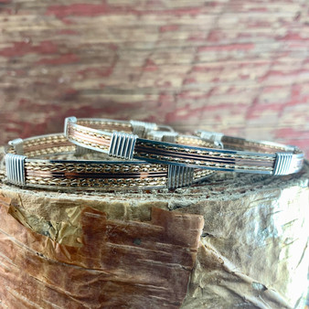 "This Tri-Metal 8 wire bracelet is available in the 8 wire band along with an optional 6 wire band. This Wired Out Of Hand wire wrap bracelet will quickly become your ""Go To"" choice for the on the go lifestyle you lead... goes with everything,  a timeless treasure."