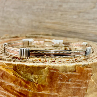 Shown is a Tri-Metal 6 wire bracelet with our New Classic style band. This takes the guess work out of what you can wear this with, it goes with everything!  You will look great wearing this by itself or stacking it with other treasures. Express your uniqueness with our quality handcrafted heirloom jewlery. Satisfaction Guaranteed.