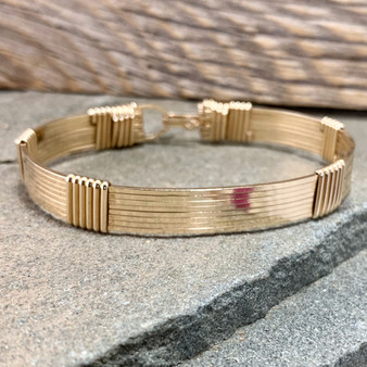 Shown is an all Yellow Gold 8 wire bracelet, style #H812Y. We offer this Minimalist Style (no wires twisted) band with 4 other option styles. We also offer 21 different metal choices so you can HAVE IT OUR WAY. Have fun BUILDING A BRACELET today.