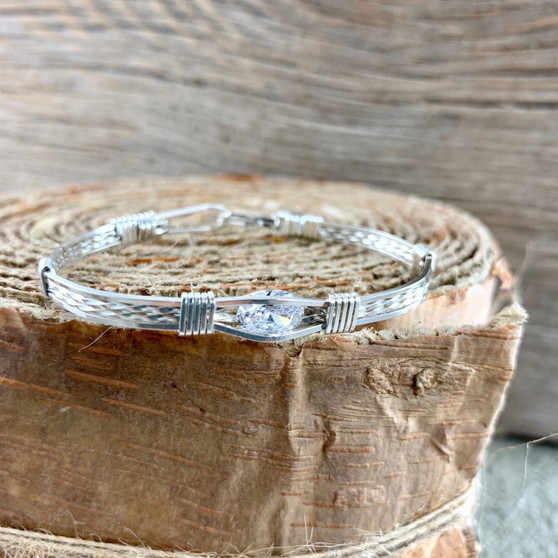 """An ALL STERLING SILVER with this custom Swarovski Cubic Zircon RETAILS FOR $99. Express yourself with this fun everyday choice """"Go To""""  accessory! This photo shows an all silver bracelet band with a Swarovski Gemstone. This is a great all round bracelet that will not only become an heirloom but honestly you can wear this with everything! Fit for a queen!"""