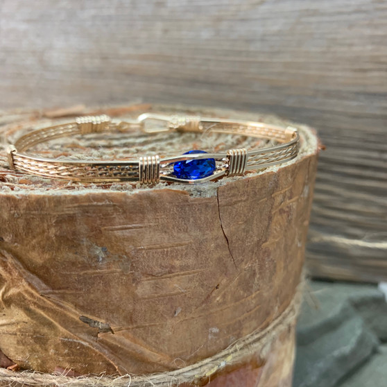 Are you looking for a great everyday jewelry items that is simple yet elegant and very functional? This synthetic sapphire bracelet is a sure bet to become a treasured heirloom. Shown in a classic all yellow gold band that retail for $139. With the blue stone and the gold band goes along with almost everything!