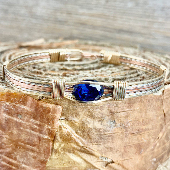 Enjoy this beautiful tri-metal wire wrap bracelet with all of your favorite outfits. This versitile gemstone is a royal blue color and shown paired up with all three metals. This will easily become your favorite to wear from work to an evening out in style.