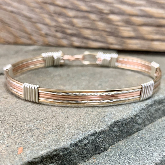 Style #6411S is similar to #6415 but the pattern features the Rose Gold in the center instead of Argentium Sterling Silver. You also have the option to choose the wrap wires, instead of Silver you can choose Yellow or Rose Gold. Each one brings a different look to the overall finish bracelet.