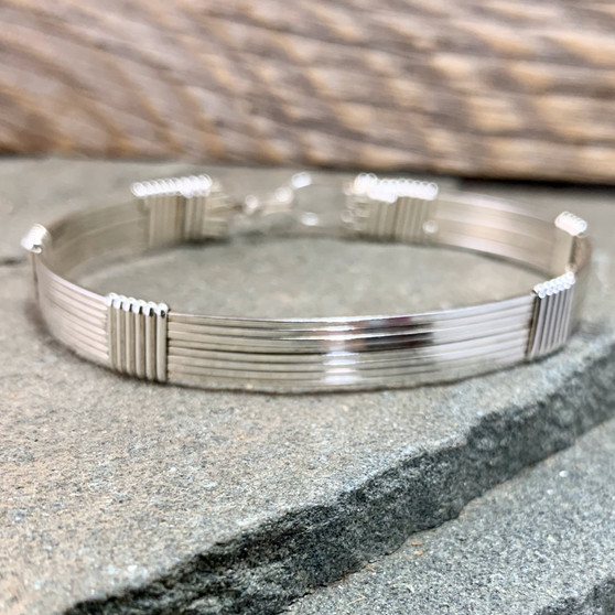 """If you love an all silver bracelet, this will quickly become your favorite.  We use the very best material available to handcraft an heirloom treasure. The Argentium Sterling Silver is a tarnish resistant metal that oxidizes to a soft platinum patina. This is in stock in a finished size 7""""."""