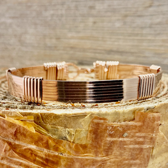 "All Rose Gold 8 wire bracelet shown in a Minimalist Style Band. This gold is an ""Old English Rolled Gold"" which is a layer of 14 Kt bonded to a center core of brass. Looks and feels like a solid 14 Kt bracelet but is more durable and less expensive. Satisfaction Guaranteed."