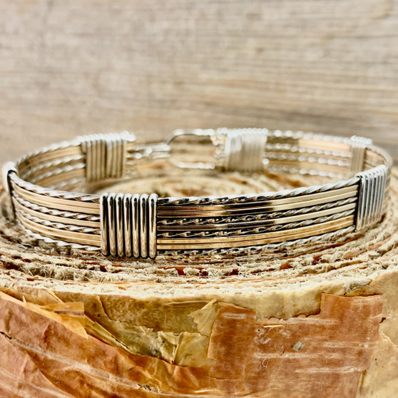 This modified Fancy style wire wrap bracelet features Yellow Gold combined with Argentium Sterling Silver. If you like a substantial feel to your bracelet then you've come to the right place. This bracelet is all you need for an everyday look. Satisfaction Guaranteed.