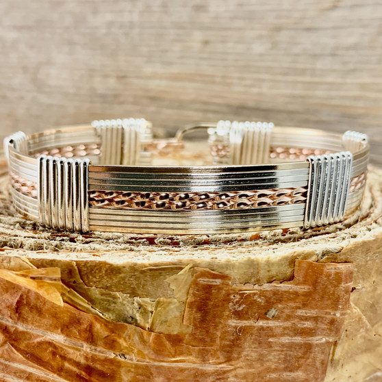 "This Classic style wire wrap bracelet features a Tri-Metal band with a substantial heavy 18 gauge wire. This is IN STOCK in a finished size 7"". This is part of the Wired Out Of Hand Collection and is one of those bracelet you will never get tired of wearing! Satisfaction Guaranteed."