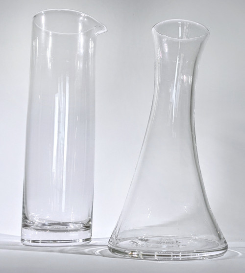 Two pitchers, the Modern Carafe on the left, and the Wave Carafe on the right