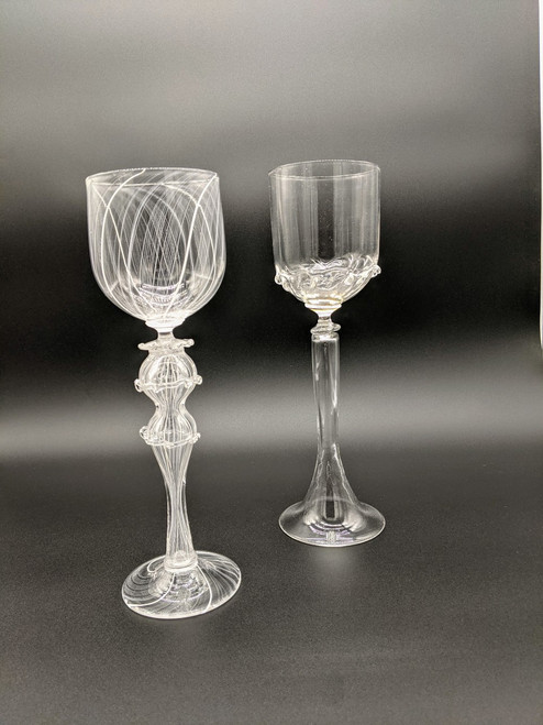 Picture of two goblets, the Wedding party on the left and the bridal party on the right