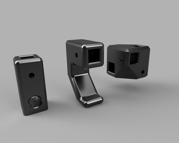 Rendering of the components left to right - String Tube Block, Chassis Hook, and Tubing Block