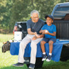 Caire Freestyle Comfort Portable Oxygen Concentrator Shown with grandfather and grandson