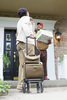 SimplyGo  Portable Concentrator Shown on two-wheeled cart