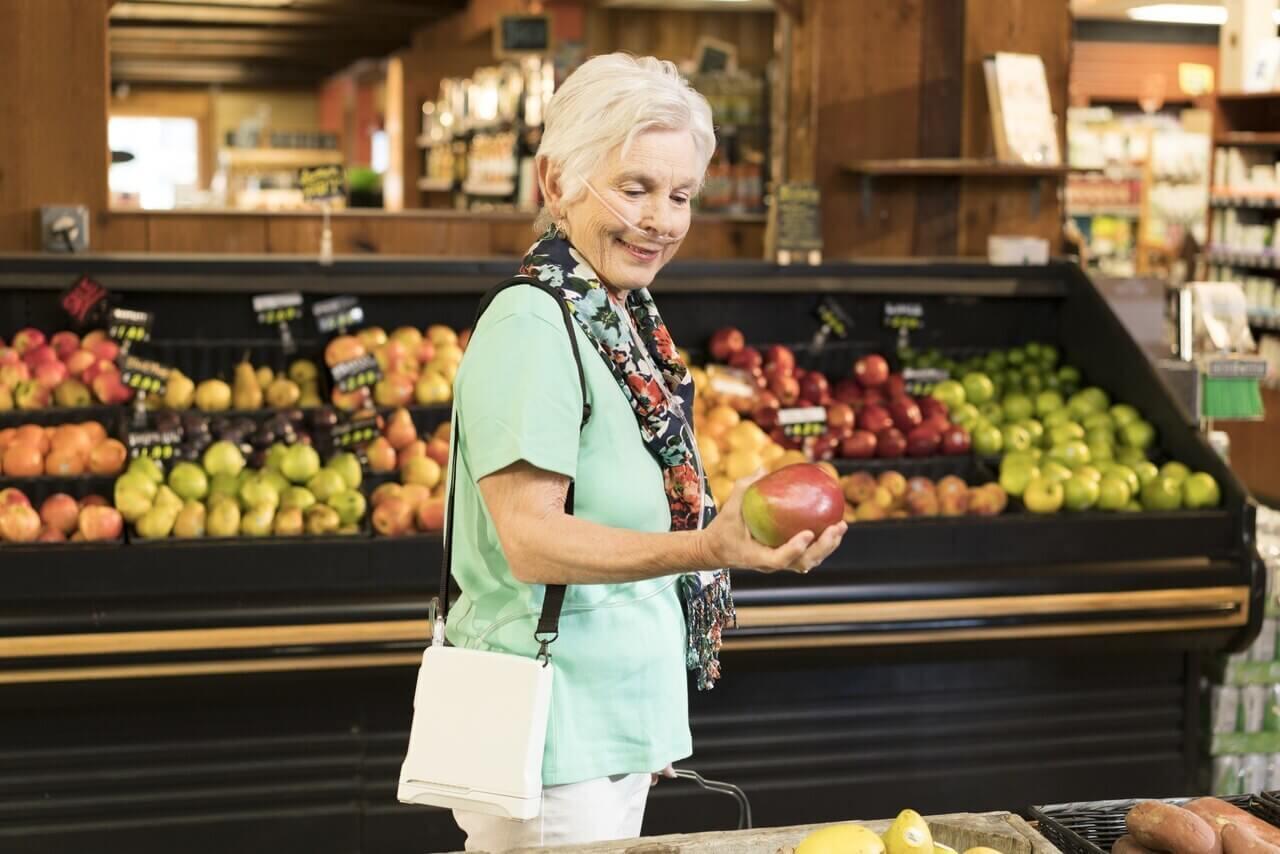 Inogen One G4 Lady Wearing in Grocery Store