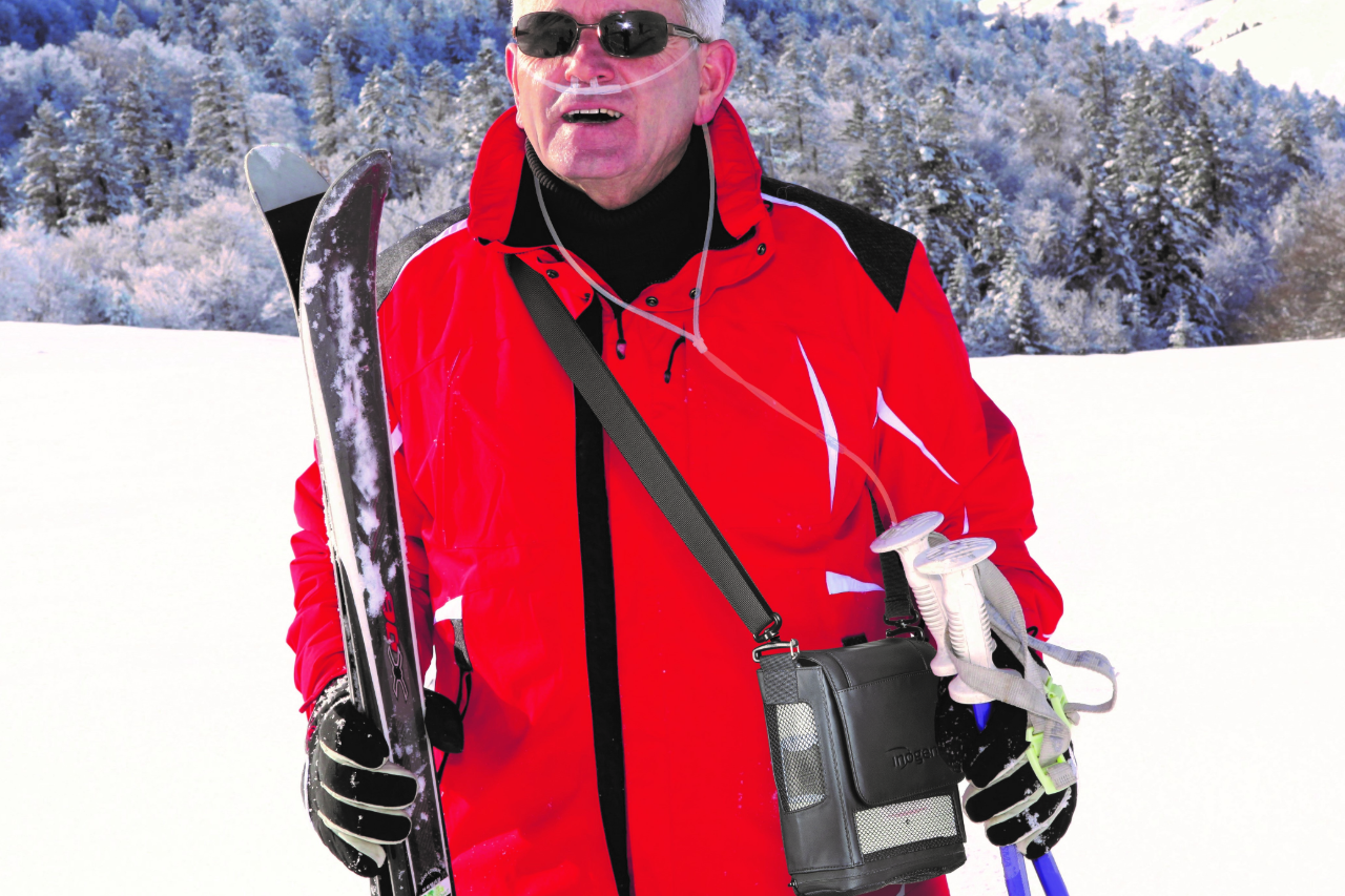 Inogen One G5 Portable Oxygen System Shown in use while skiing.