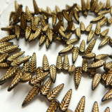 5x17mm Bird Feather Drop Jet Gold (25 beads) Pressed Czech Glass