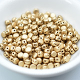 Kalos® par Puca® (50 beads) 2-Hole 4x3mm Drum Shape - Light Gold Matte - Czech Glass
