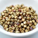 Kalos® par Puca® (50 beads) 2-Hole 4x3mm Drum Shape - Yellow Gold Metallic Iris - Czech Glass