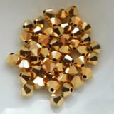 Preciosa 4mm Bicone M.C. Crystal Full Aurum (24 Beads)