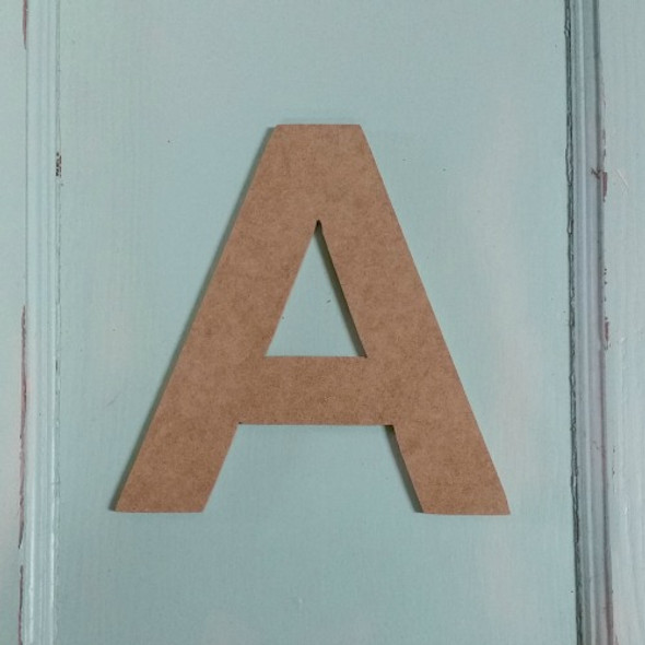 Wooden cut out letters are cheap unpainted wood letters.