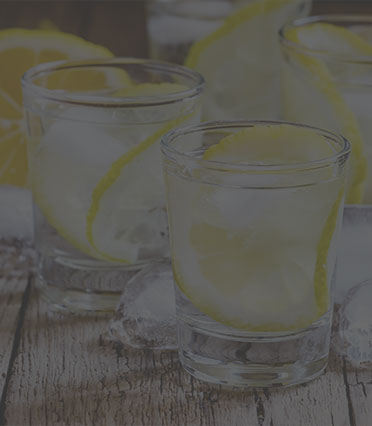 Glasses with a slice of lemon and ice