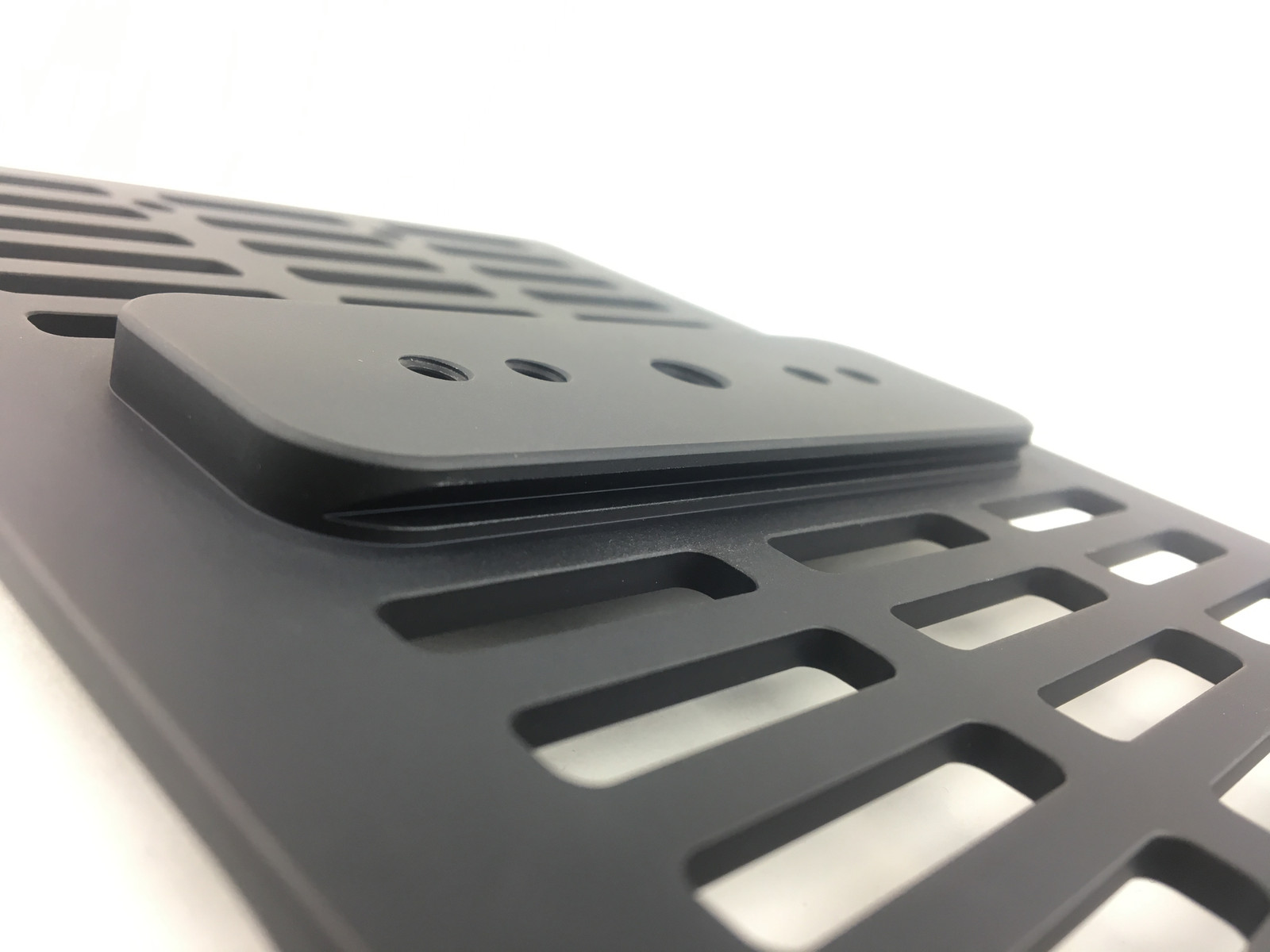 Close up view of the integrated Arca Rail on the bottom of the Abel Table.