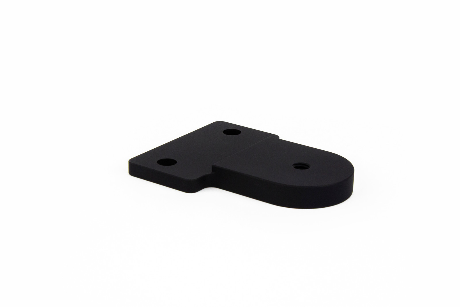 Picture of Abel Company's Small Offset Mount (SOM) adapter with a white background. Side view of the adapter.