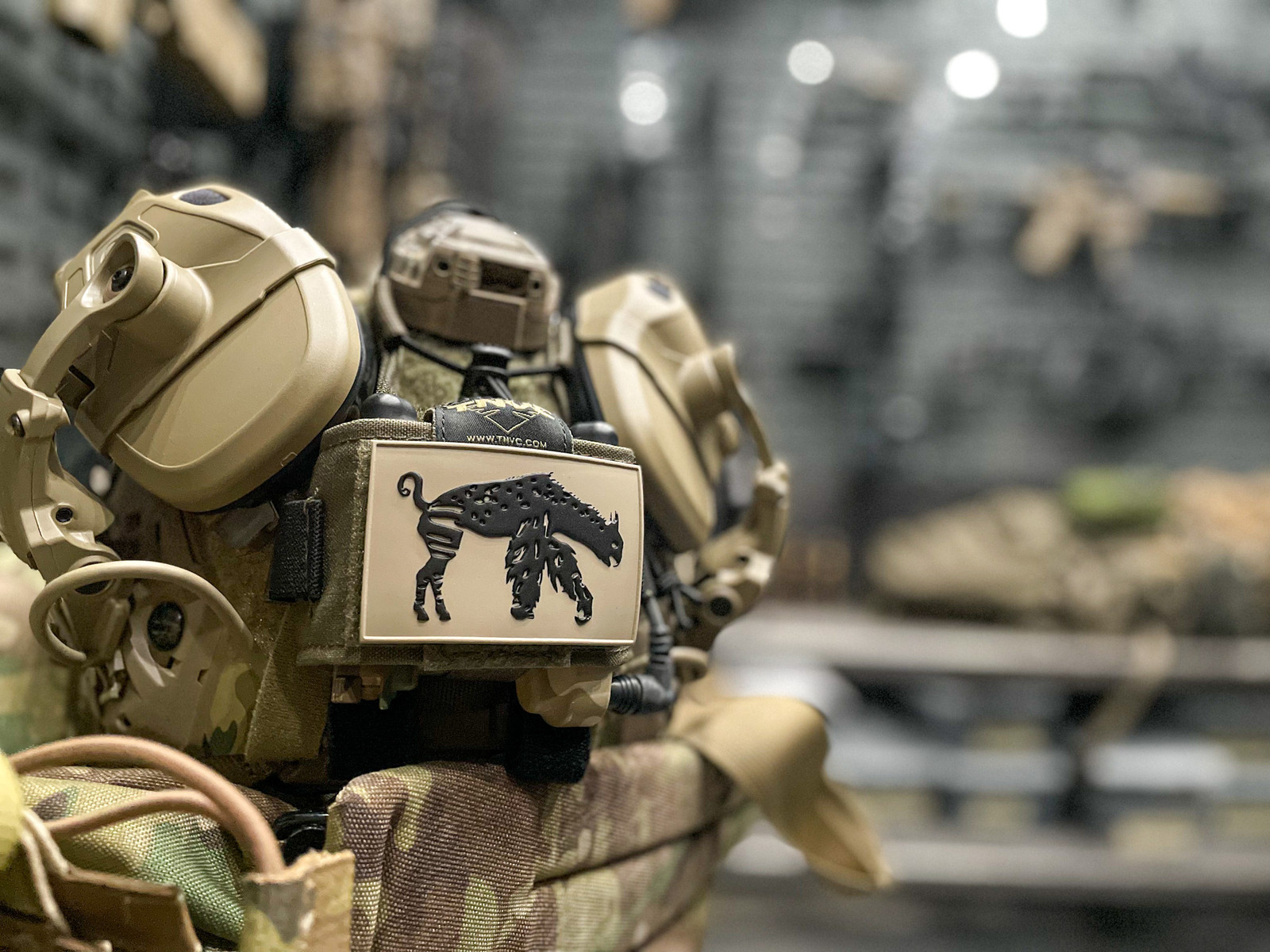 Picture of tactical helmet system with an Abel Company FDE creature patch, the creature is black on an FDE background.