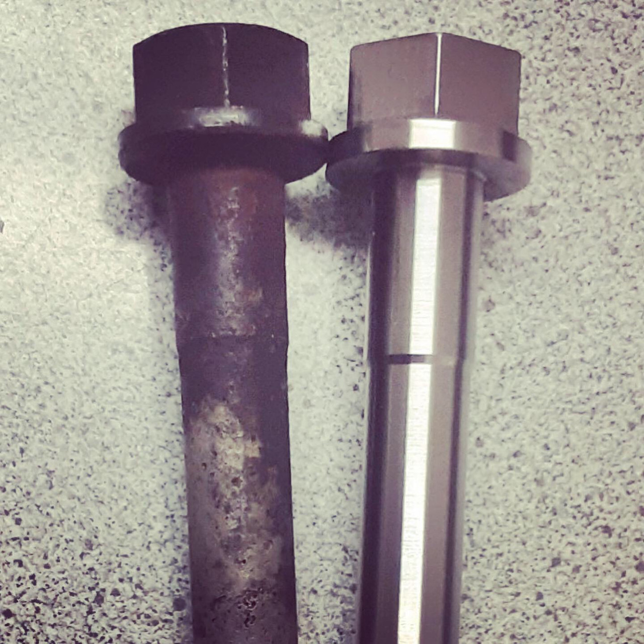 3FE Head Bolt- Front (HBF-3) compared to an old 3FE bolt