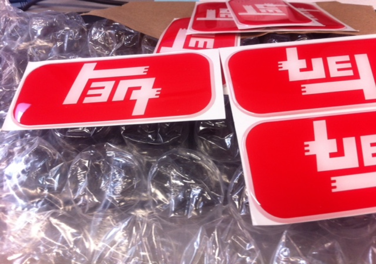 TEQ domed stickers by Wits' End