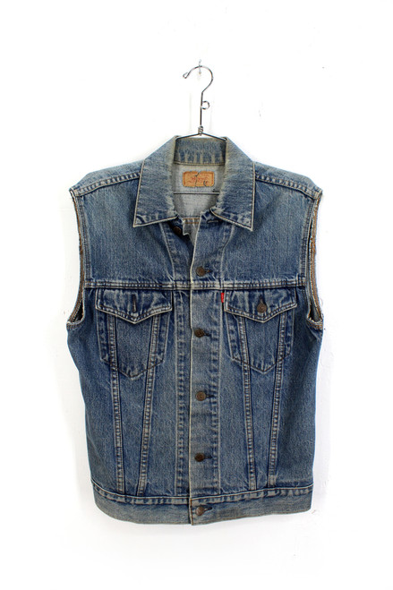 Levis cut off denim vest. Made in USA .   Fits like a Small.  Size 34.
