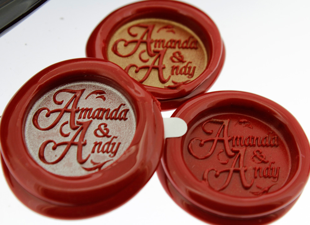 Example of Double Name Design wax seal impressions taken from engraved wax seal, showing silver or gold highlight achieved with Encore Stamp pad (available from 'Tools & Accessories') and plain red wax.