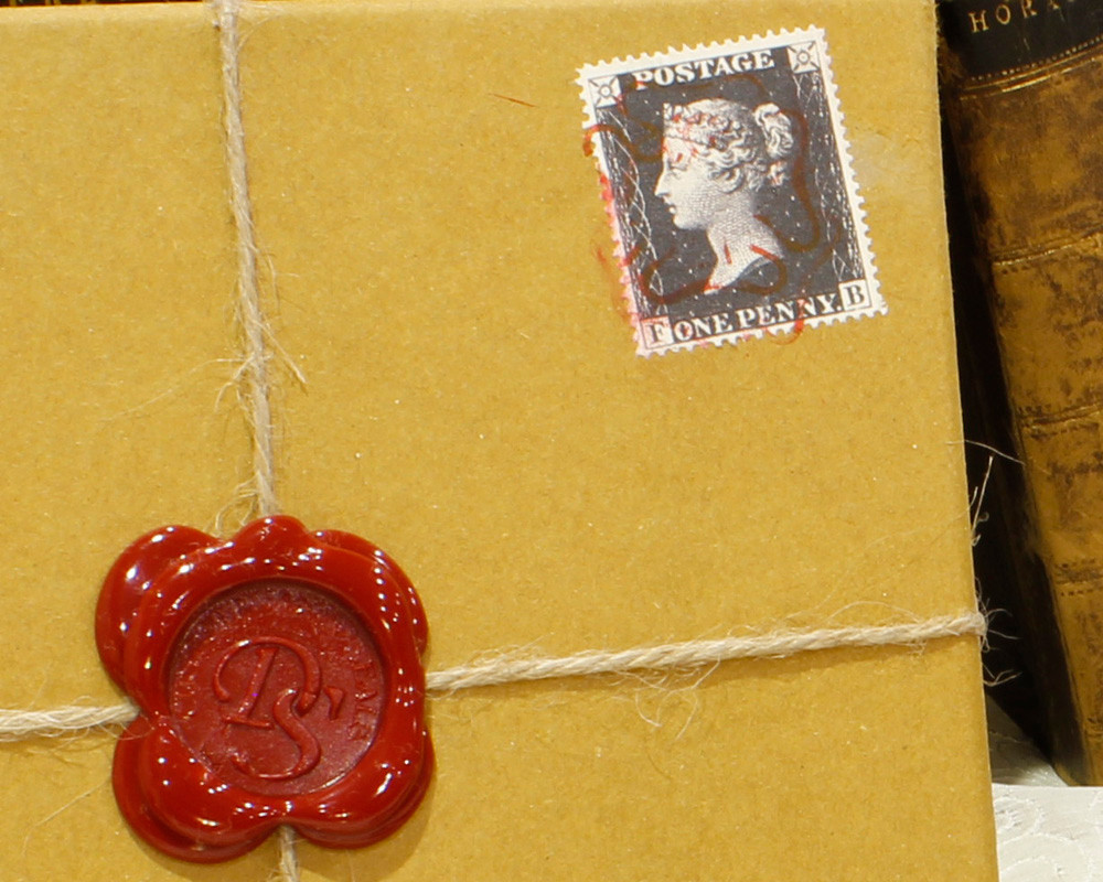 Authentic Reproduction Penny Black Franked Stamp with customers own design wax seal on outer package.