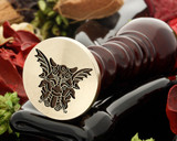 Gargoyle wax seal, reversed for engraving