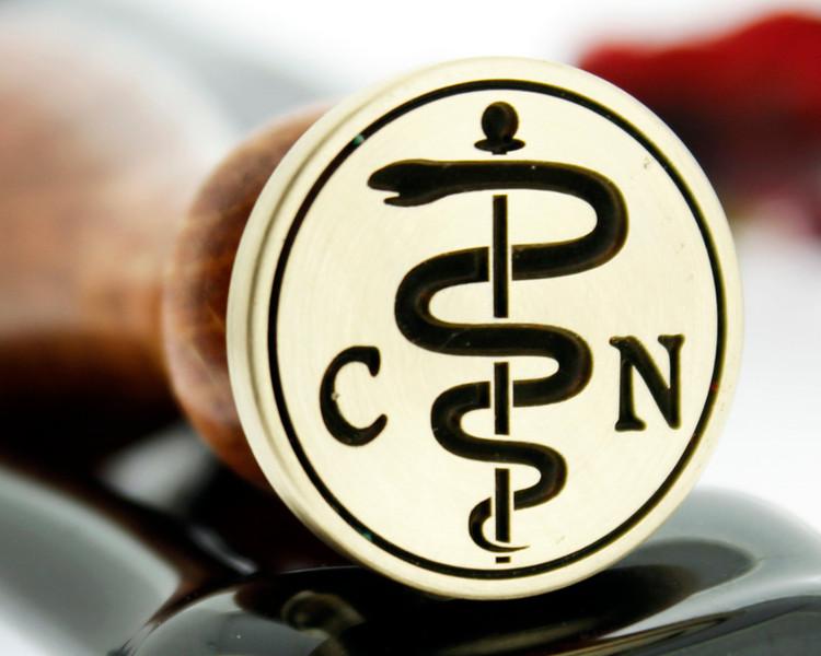 Healing 1 Cadaceus - initials extra cost.   Photograph reversed