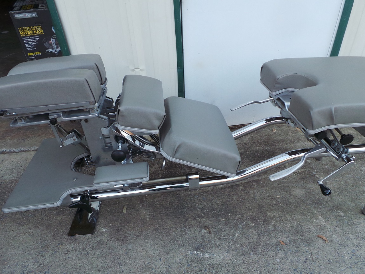 Used Zenith 55F Stationary Table with Cervical Elevated & Breakaway Chest open and in Down position
